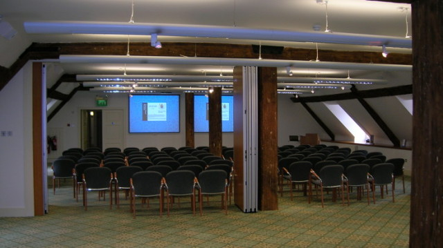 New Armouries Meeting Suite set out in theatre style with chairs facing presentation facilities Tower of London Venue Hire EC3