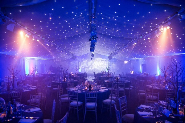 Conservatory at Painshill Christmas Party KT11. banqueting tables set out with decorative lighting