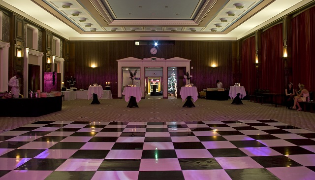 Poseur table and dance floor layout for a Christmas party in the Nuffield Hall Rooms on Regent's Park Christmas Party NW1