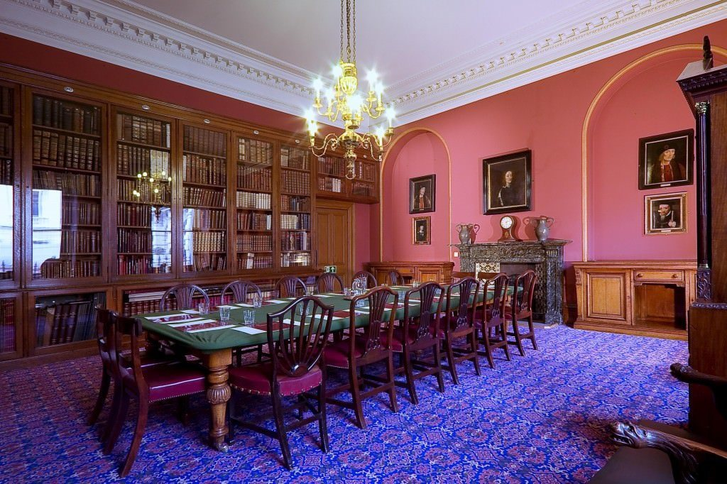 Society of Antiquaries Venue Hire W1, board room set up in a private room with pink walls
