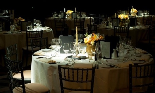 South Place Hotel Christmas Party EC2. Dining area with flowers as centre pieces. Christmas feel to venues space.