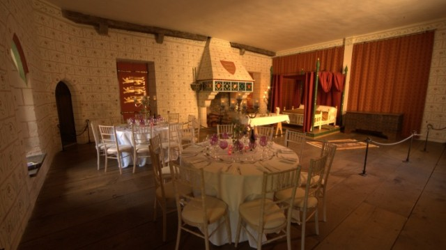 St Thomass Tower Suite set for a dinner party with round tables dressed in white linen open fireplace and historic decor Tower of London Venue Hire EC3