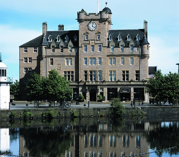 Malmaison Edinburgh Christmas Party EH6, outside of venue with brick walls and pond out the front
