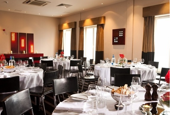 Malmaison Edinburgh Christmas Party EH6, resturant with round tables and white table covers