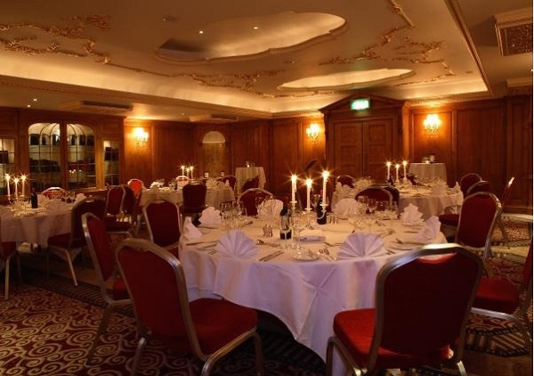 Westbury Mayfair Hotel Christmas Party W1. Venue in evening set up for Christmas dining with candles lit in centre of table for festive feel.