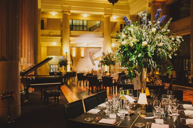 Banking Hall Christmas Party EC3, well presented dining space with piano and decorative flowers.