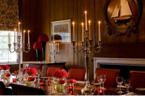 Devonport House Shared Christmas Party SE10, christmas dinner set up, banqueting table with candelabras, festive colour scheme