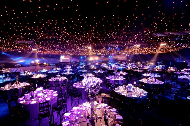 Battersea Evolution Venue Hire SW11Battersea Evolution Venue Hire SW11 set up for a Christmas party with fairy lights in the ceiling with round tables dressed for dinner