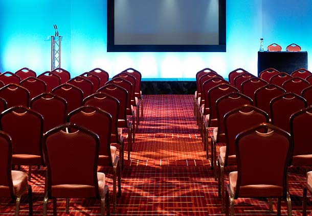 Cheshire Suite in theatre style with presentation screen for a meeting Manchester Airport Marriott Hotel Venue Hire WA15
