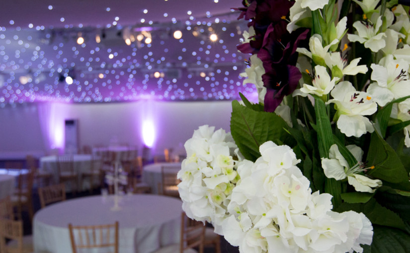 Conservatory at Painshill Venue Hire KT11, stunning flower decorations, seated dinner event