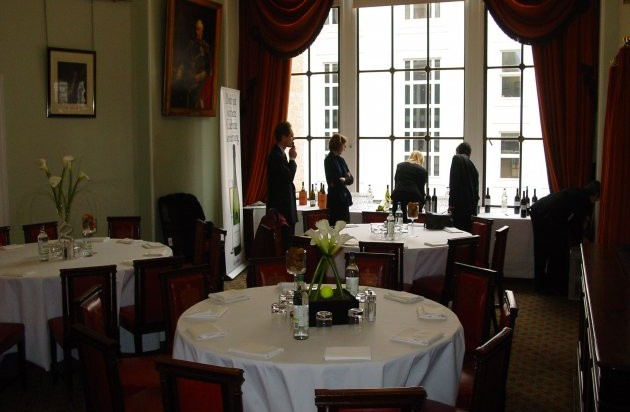 Pepys Room with guests enjoying the natural daylight with round tables with floral centre pieces Trinity House Venue Hire EC3