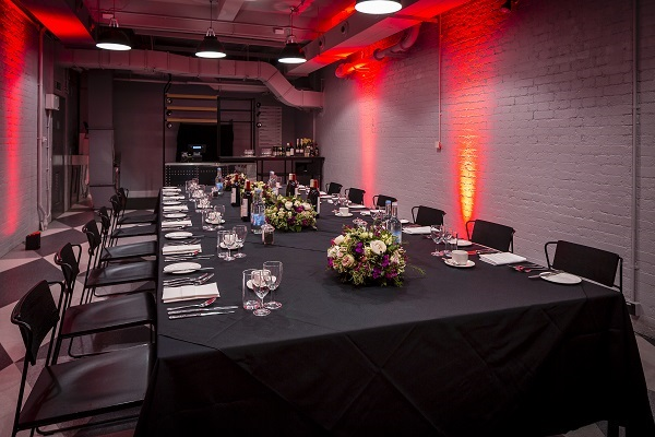 Churchill War Rooms Christmas Party SW1. Large private dining room with decorative lights shining onto the walls giving off a festive ambience.