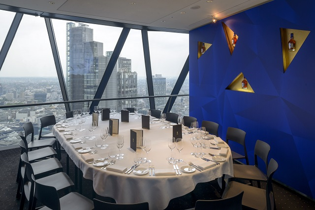 Gherkin Venue Hire EC3. Priavte room with oval table and chairs around table, large windows that you can see views of the city. have a comtempary feel.