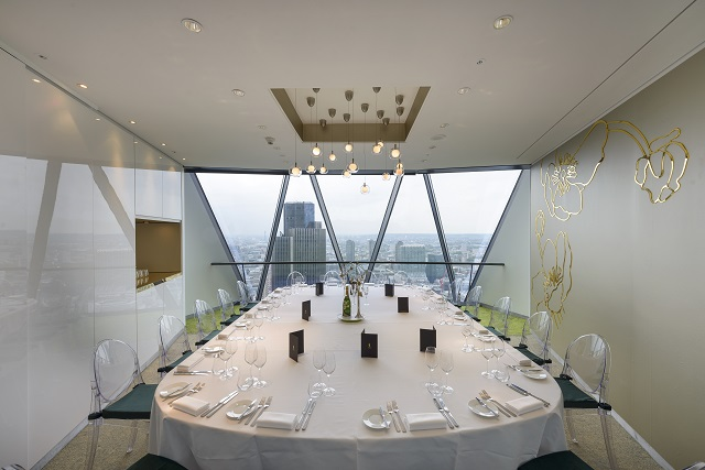 Gherkin Venue Hire EC3. Airy, large board room with oval table and chairs around.
