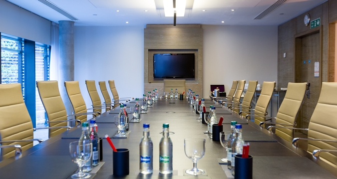 Hilton London Tower Bridge Venue Hire SE1, board room set up with water and screen