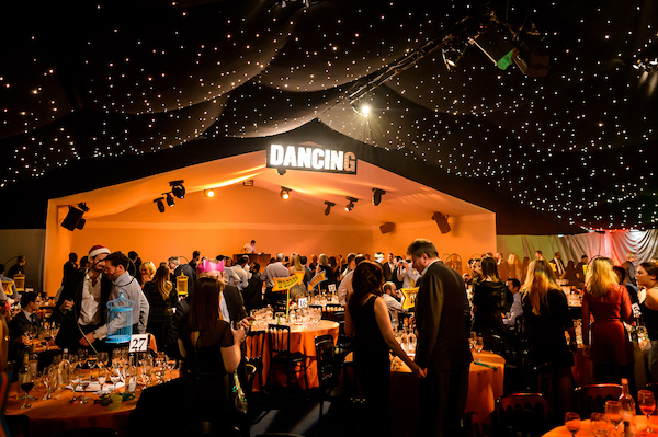 Wonder Nights Shared Christmas Party EC1 venue with disco floor and dj playing music and guests dancing