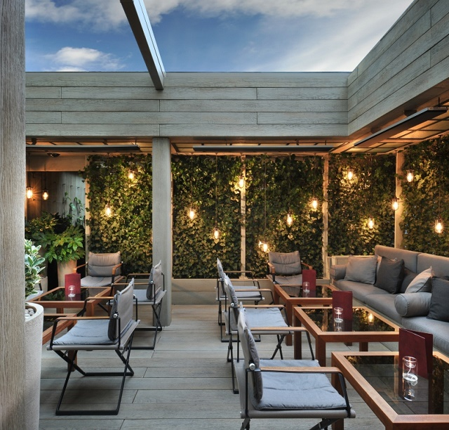 Hari Summer Party SW1 Lounge with tables and chairs with windows above for daylight to shine through venue