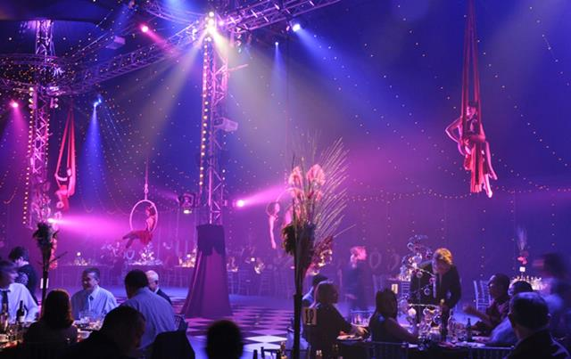 view of the Ariel entertainment hanging from the marquee Bloomsbury Big Top Christmas Party WC1