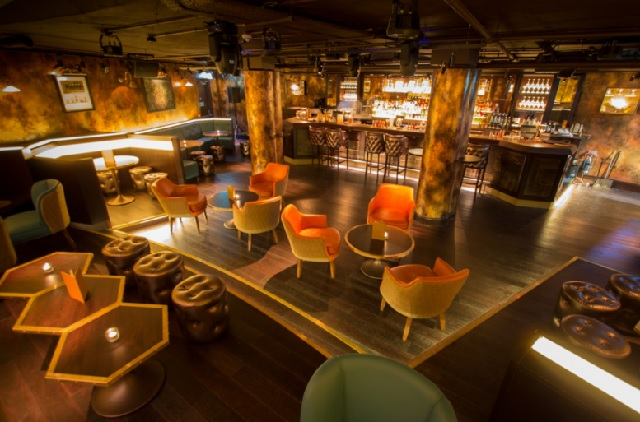 Birds eye view of the downstairs Soda Room with informal sofa seating and private bar Botanist Broadgate Circle Venue Hire EC2