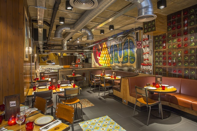 Camino Blackfriars Venue Hire EC4. Restaurant with quirky Spanish painting on the wooden panelled walls with informal bench sofa seating Camino Blackfriars Venue Hire London, EC4