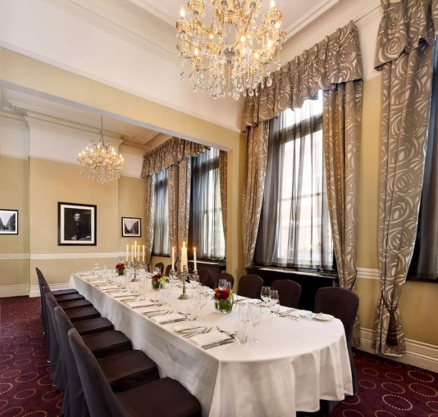 Table dressed in white linen for a banquet in the Samuel Room Chiswell Street Dining Rooms Venue Hire EC1