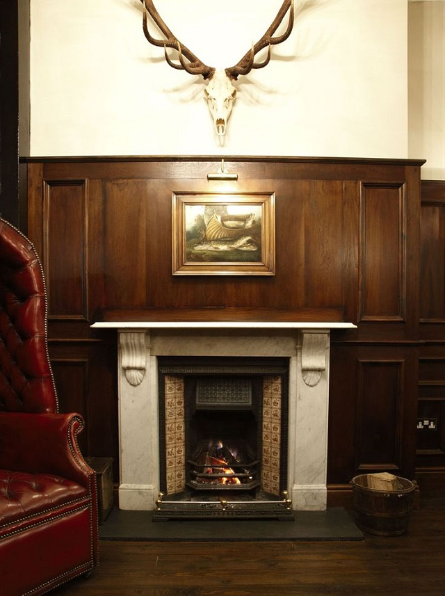View of the traditional fire place with antlers hanging above the mantle piece Hat and Tun Venue Hire EC1