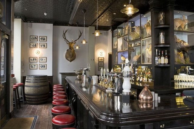View of the bar area with red high stools and cask ales Jugged Hare Venue Hire EC1