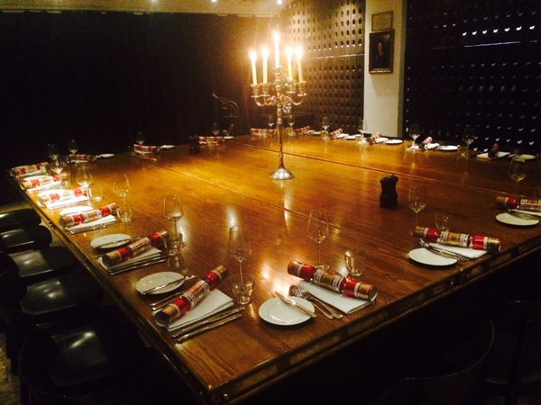 Josephine Private dining room set for a christmas dinner with exposed brick work and fixed oak table Jugged Hare Christmas Party EC1