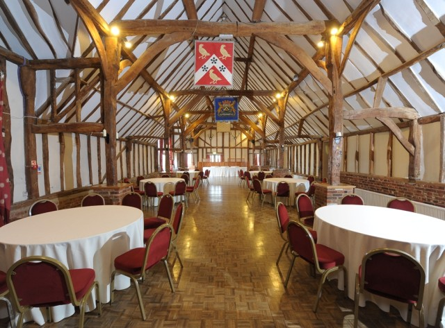 wooden beams in room with white cabaret seating