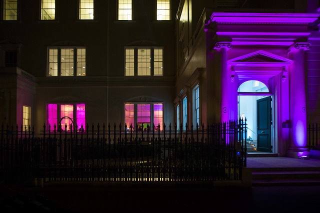 Prince Philip House Summer Party SW1 front of building with purple up lighters
