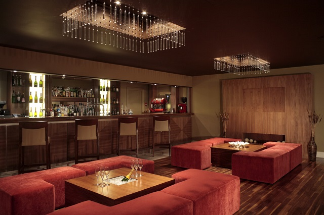 Felbridge Hotel Christmas Party RH1. Qube Bar, lush lounge area with red sofas and airy feel.