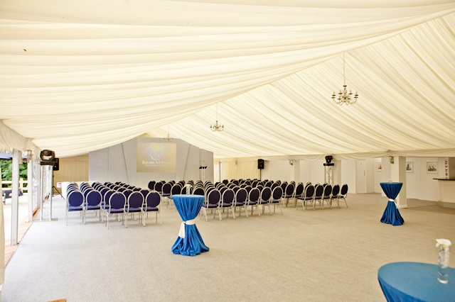 Ravens Ait Island Summer Party KT6. Marquee set up, with chairs laid out boardroom style.