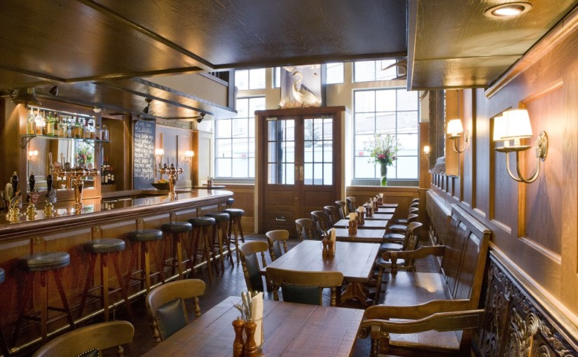 Pub level with view of the bar with natural daylight and open entrance White Swan Venue Hire EC4