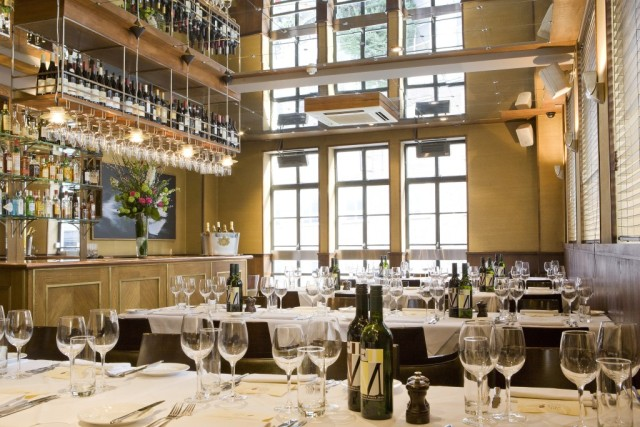 Restaurant view with glasses set for dinner and private bar area White Swan Pub Bar White Swan Venue Hire EC4