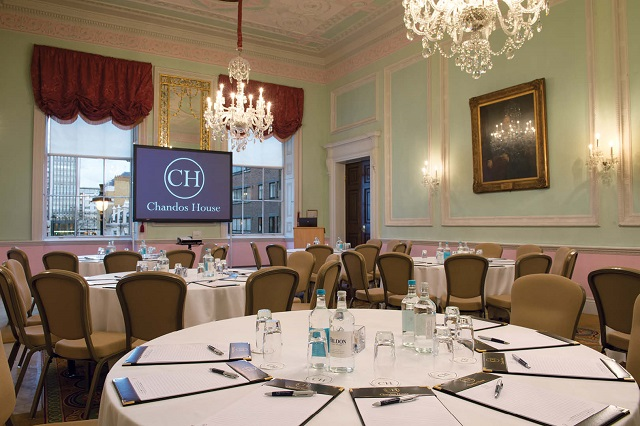 Chandos House Venue Hire W1. Room set up for a conference, set up cabriet style with screen infront.