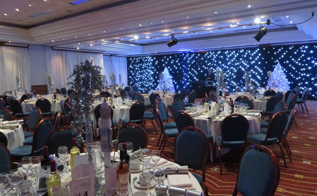 Newcastle Gateshead Marriott Christmas Party NE1. Tables and chairs set up for Christmas party/seated dinner.