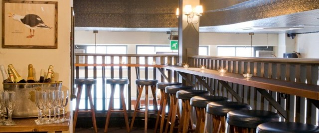Mezzanine with informal bar stool seating over looking lower ground pub with restaurant above White Swan Venue Hire EC4