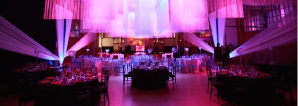 Brighton Dome Christmas Party BN1. Dome lit up with colourful lighting for a festive feel.