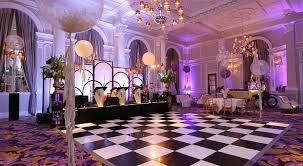 Ballroom set for a christmsa party with dance floor and stage with a band and natural daylight Corinthia London Christmas party SW1