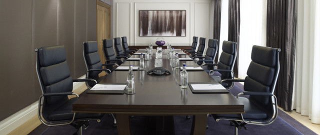 Victory Room set in boardroom style for a meeting with tall back leather chairs Corinthia London Venue Hire SW1