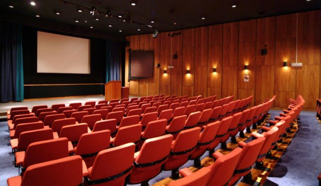 Flett Theatre with informal seating in tiered theatre style facing presentation facilities Darwin Centre Natural History Museum Venue Hire SW7