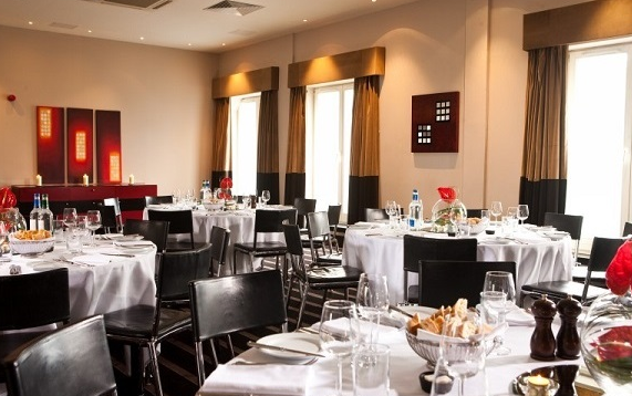 Malmaison Hotel Edinburgh Venue Hire EH6, resturant with white table cloths on round tables
