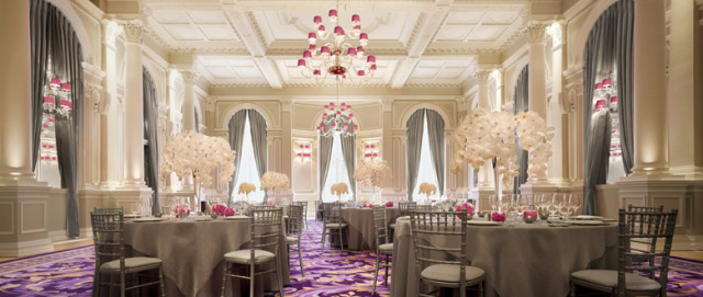 Ballroom set for a dinner with natural daylight round tables and giant floral centre pieces with natural daylight Corinthia London Christmas Party SW1