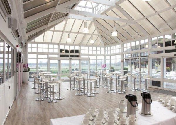 Haydock Park Racecourse Venue Hire WA12, stunning open room, high ceiling, floor length windows