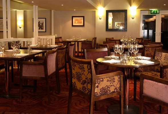 Restaurant set up for dinner Hallmark Hotel Manchester Venue Hire SK9