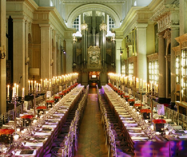 Photo of 2 large, long dining rooms.. Tables decorated with a festive touch.