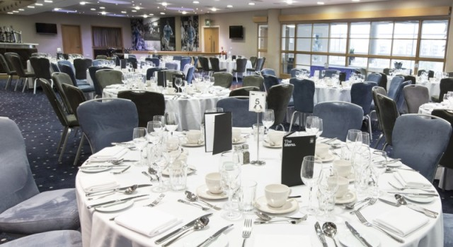 Round tables dressed in white linen for a dinner party in the1894 Club Manchester City Football Club Venue Hire M11