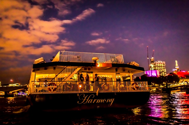 Harmony at night with view of london nigh skyline in the background Bateaux London Christmas Party WC2
