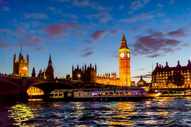 view of London at night with big ben in sight on the Bateaux London Christmas Party WC2
