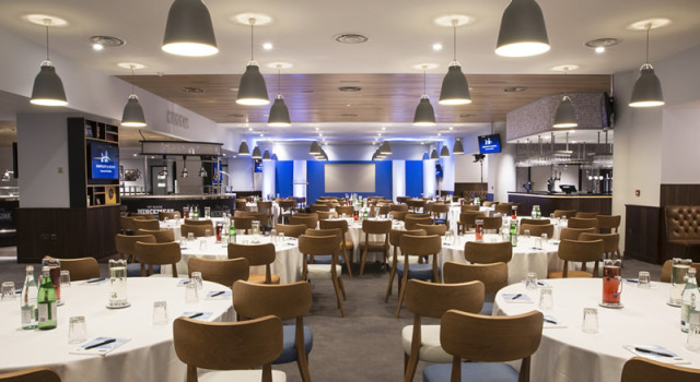 Tables dressed and set out in cabaret style for a business meeting in the Citizens Manchester City Football Club Venue Hire M11
